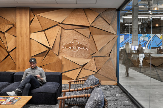 white oak panels hand-finished in veneer and stained with Dutch oil. backlit with Philips HUE lights. Photo by Garrett Rowland