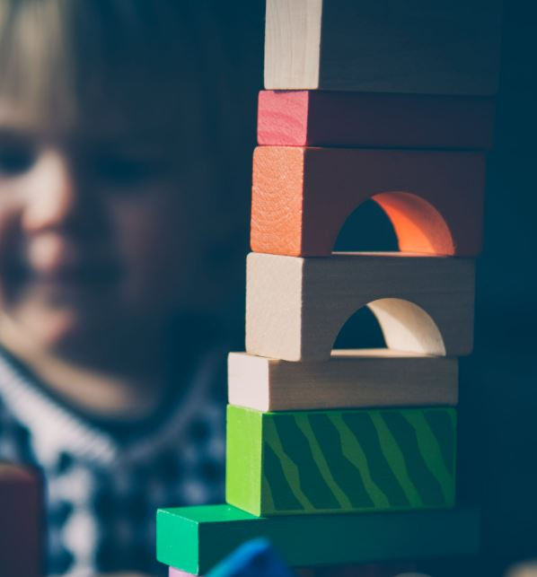 child with wooden toy blocks