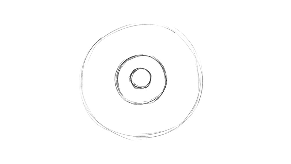 Step 2 of drawing a realistic eye: two more smaller, concentric circles are drawn within the first