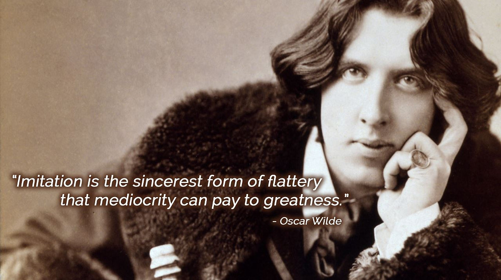 "An image of Oscar Wilde. His quote ""Imitation is the Sincerest Form of Flattery that Mediocrity Can Pay to Greatness"" is written to his left."