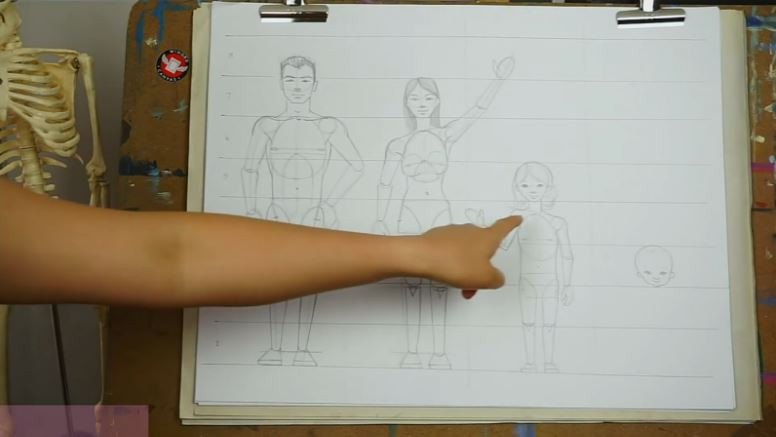 Fei Lu gestures towards her illustration of the child figure