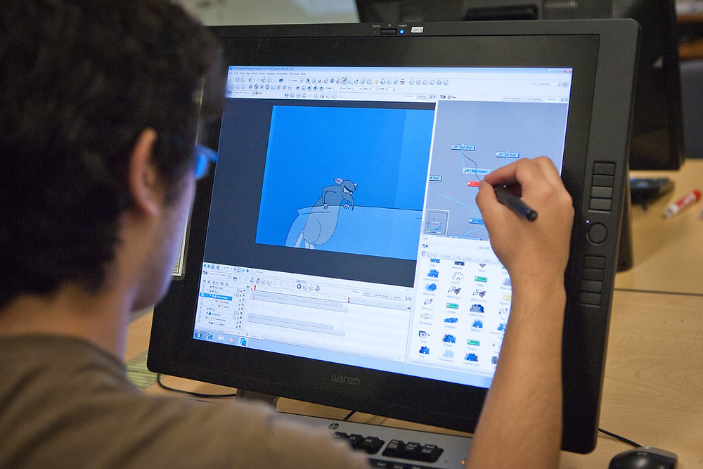 """A photo of a man animating on a screen tablet. """"VFS Classical Animation: Digital Ink & Paint"""" provided by Vancouver Film School."""