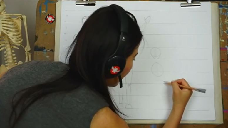 Fei Lu continuing to sketch the child. There is now a ribcage drawn