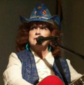 Rita Faye in blue hat head shot.jpg