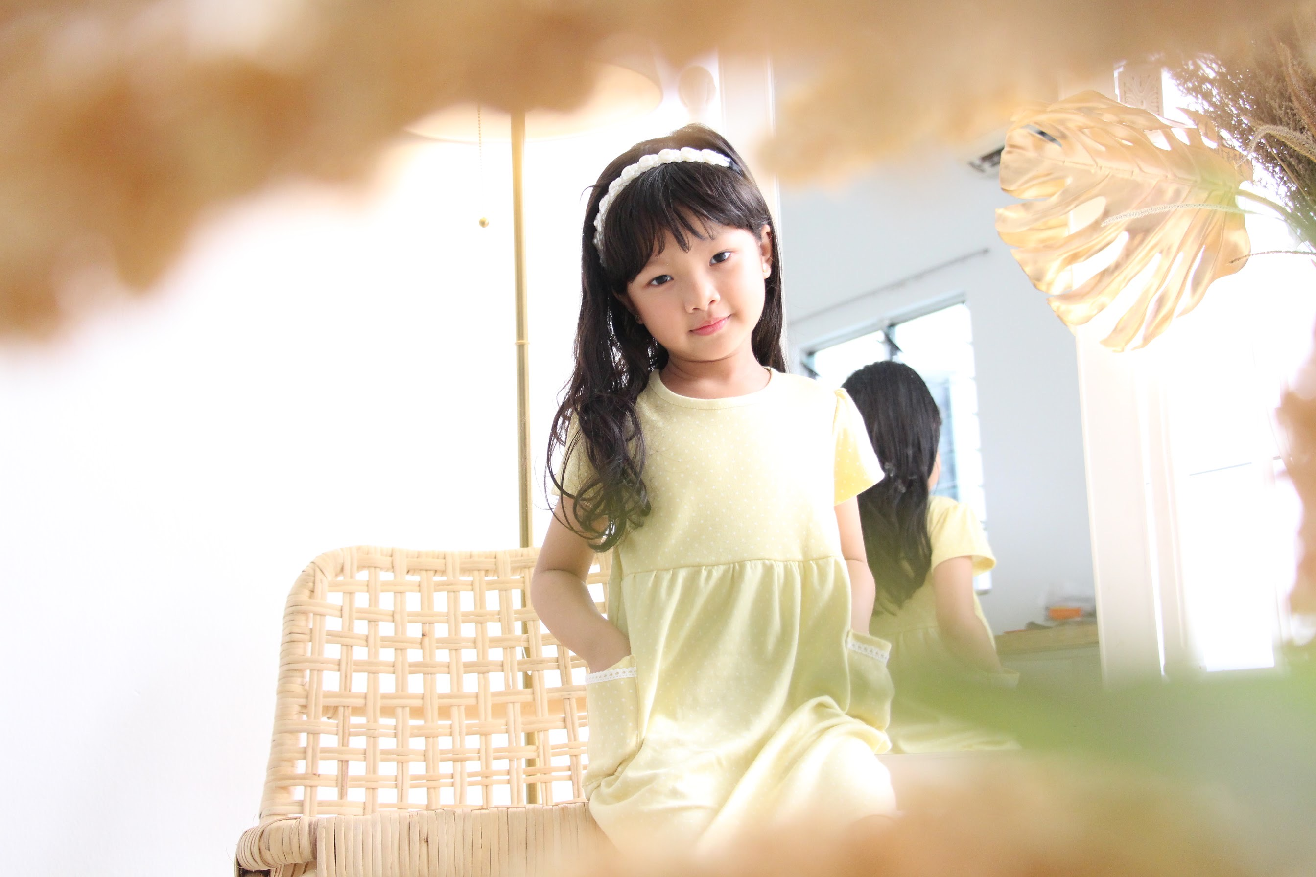 A cute girl wearing a yellow dress