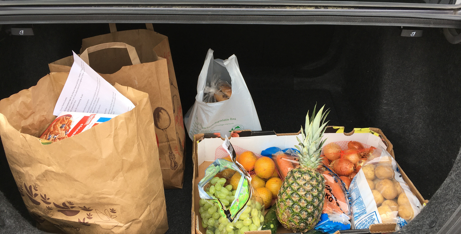 Our hands-free pick up system places groceries directly in the trunks of our client's ca