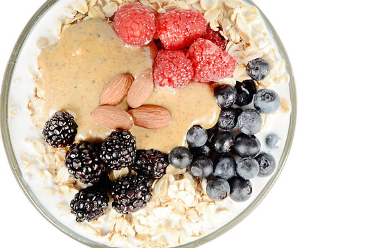 bowl with oatmeal with rasberries, blueberries, and a dollup of nut butter