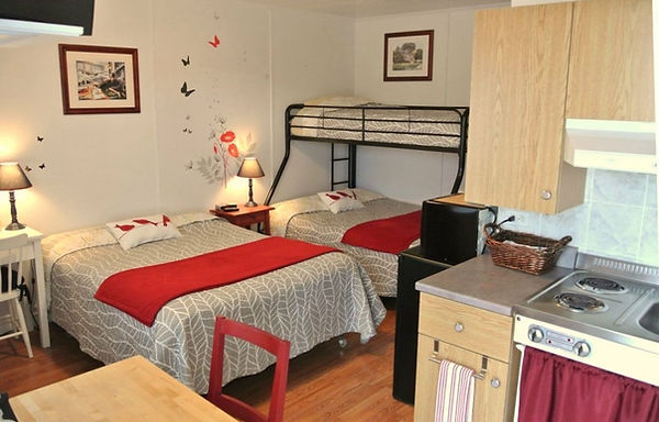 chambre_2_avec_2_lits_doubles_et_1_super