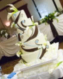 chocolate fondant wedding cake with fresh flowers