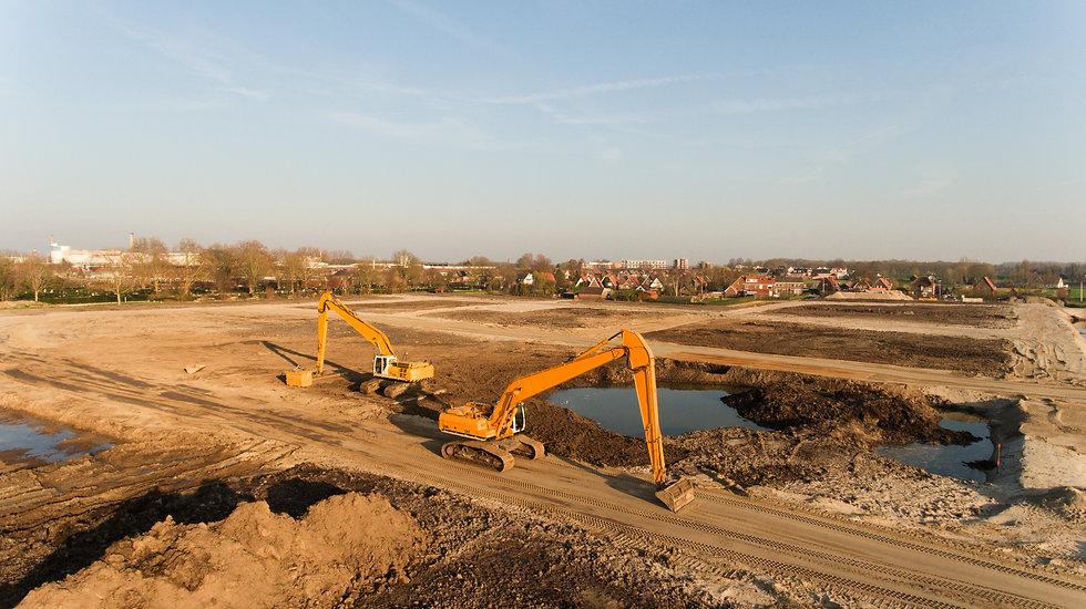 high-angle-shot-two-excavators-building-