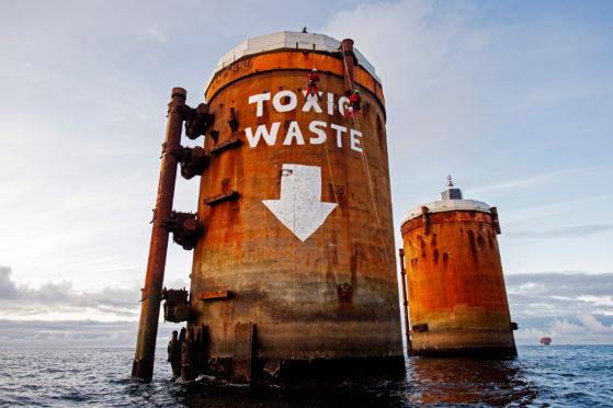 Green peace toxic waste graffitti.jpg