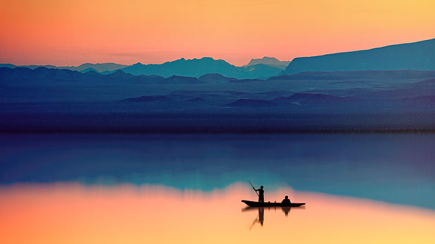 silhouette-of-person-riding-boat-2080960