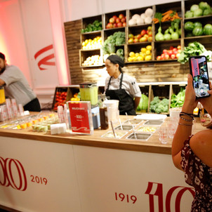 A curious guest steps up to the KitchenAid smoothie bar to taste unique creations and do their best to identify the secret ingredient in each blend in New York City, Thursday, July 18, 2019. (Clarence Sormin)