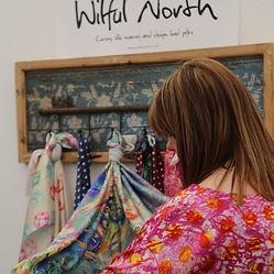 Holly arranging silk scarves
