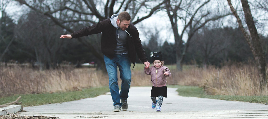 photo-of-father-and-daughter-running-at-