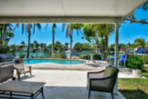 Patio View of TREASURE ISLAND WATERFRONT POOL HOME