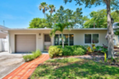 Sidewalk View of DOLPHIN WATERS RETREAT HOME