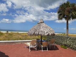 Beach tiki huts picnic