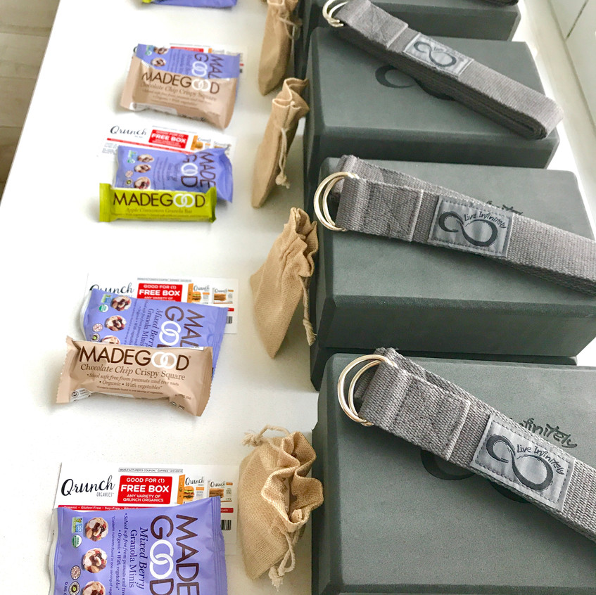 Live Infinitely yoga blocks and straps, Made Good granola bars, and Qrunch coupons for the summit