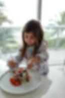 Mia eating pancakes