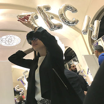 Woman making hand-gestures while wearing microsoft hololens mixed reality headset.