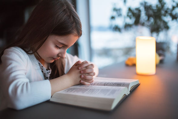 a-small-girl-praying-at-home-PTBLZVH.jpg