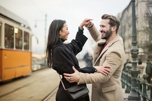 Canva - A Happy Couple Dancing On Sidewalk.jpg