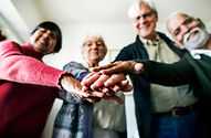 a group of seniors with hands stacked on top of each other
