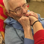 senior women kissing hand of caregiver