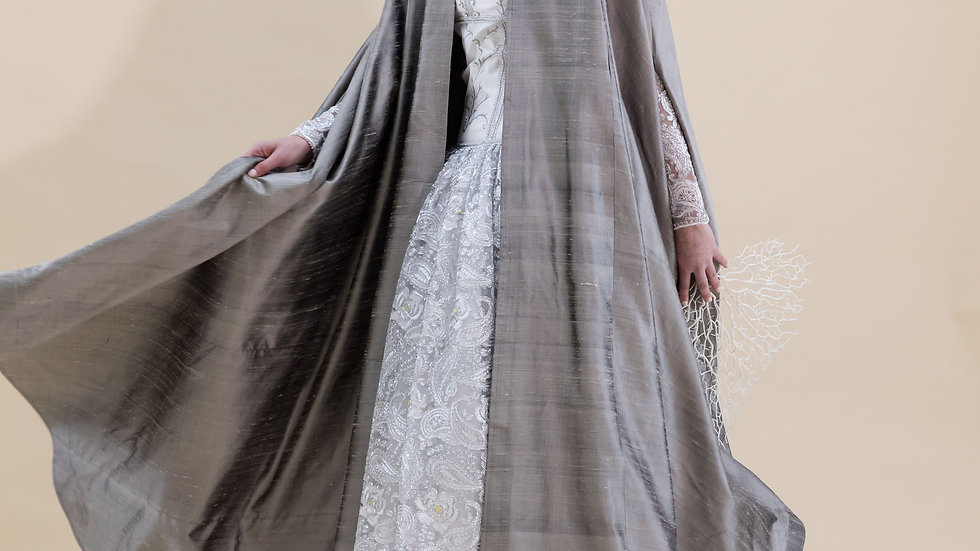 Out of a Silver Shell wedding dress and Barnous