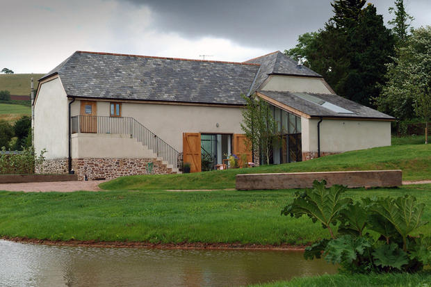 Listed barn conversion on a lake