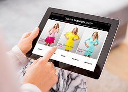 Woman shopping online for new dress.  Al