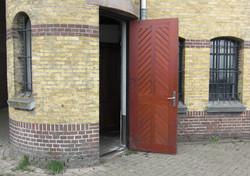 Vernieuwen deur pakhuis Het Veem