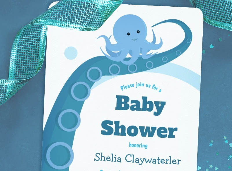 A shark baby shower invitation showing a Mom and baby shark in a blue ocean