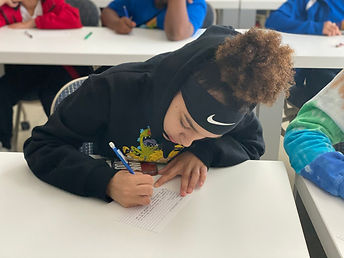 SHIELD youth participant taking notes during a mentoring session.