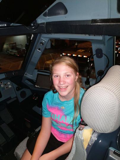 Chloe in the cockpit.