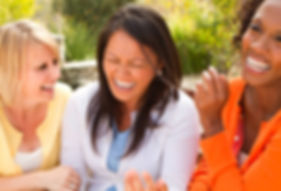 3 women friends laughing