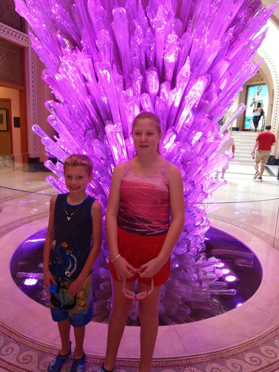 Chloe and her nephew Aaron in front of an ice crystal sculpture.