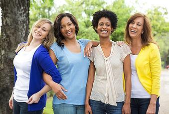 4 women friends happy