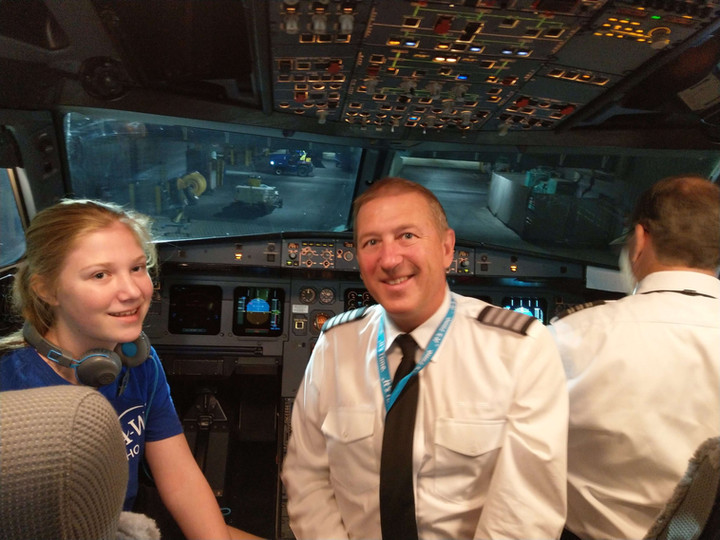 Chloe's first flight - meeting the pilots in the cockpit.