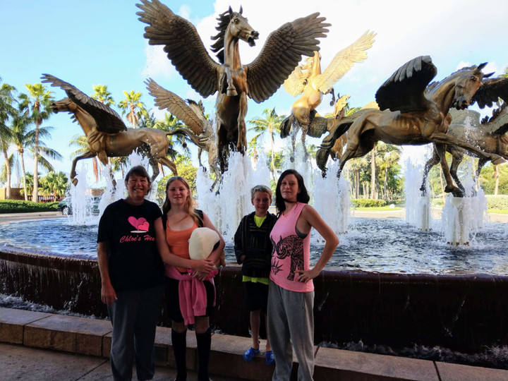 Chloe & family in front of winged horses.