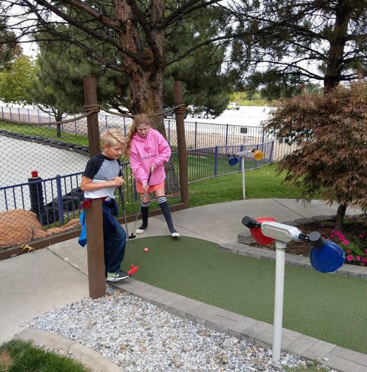 Chloe plays pee wee golf with her nephew Aaron.