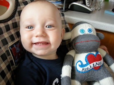 rock and roll sock monkey, sock monkey with baby