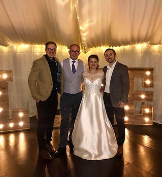 An acoustic wedding band with a happy couple after a fantastic wedding day in Huntingdon. The band has just provided music and DJ for their beautiful summer marquee wedding. The couple left a great testimonial.