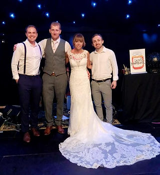 a lovely wedding in Shropshire. The wedding band are seen with a happy couple. They are very fashionablly dressed for a luxury wedding.