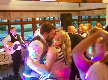 A full dancefloor at a wedding in Telford, Shropshire. Lazy Marmalade acoustic wedding duo perform to an upbeat live set at a wedding and keep the dancefloor full.