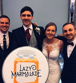 An acoustic wedding band with a happy couple after a fantastic wedding day at Pendrell Hall, Codsall. The band has just provided music and DJ for their beautiful summer marquee wedding. The couple left a great testimonial.