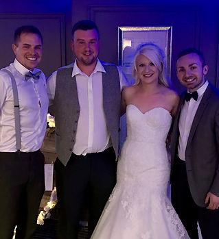 A wonderful wedding at Hoar Cross Hall. This is a photo of a happy couple and Lazy Marmalade wedding duo. The band had just performed live music and DJ throughout their evening wedding reception.