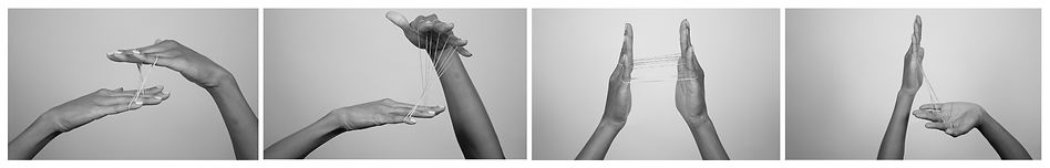 Series of 4 b&w photos of a persons hands in four different positions. Fingers connected with rubber bands.