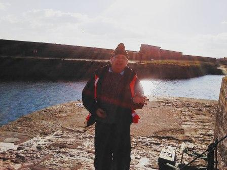 A successful fisherman with his catch at Par Harbour